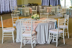Photo of an event set up with tables and chairs