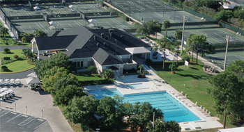 Photo aerial view of Bardmoor Golf & Tennis Club pool and clubhouse with tennis courts in the backround