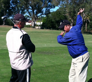 Photo Jim King PGA Director of Golf Instruction teaching a lesson