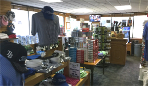 Photo 1 Lansbrook Golf Shop interior showing Shirts Hats and Golf Balls