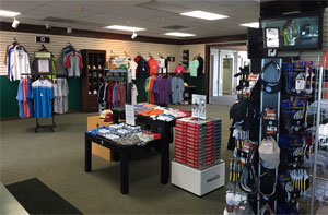 Photo Bloomingdale Golf Shop interior showing Shirts Hats Golf Balls and apparel
