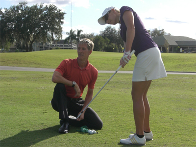 Photo J.D. Carino teaching golf lesson