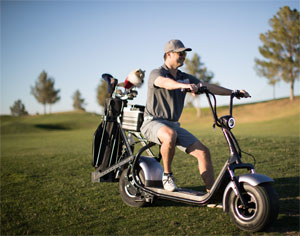 Photo golfer riding Phat Scooter