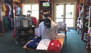Photo 2 Baytree National Golf Shop interior showing Shirts Hats and Golf Balls