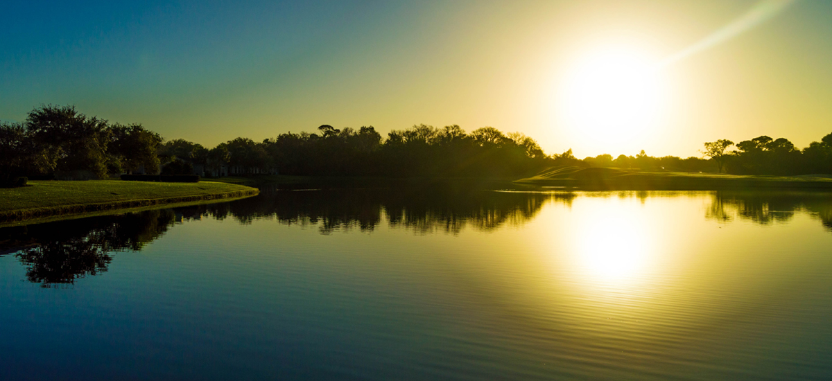 Photo Header Baytree National Sunset Over Lake on Course