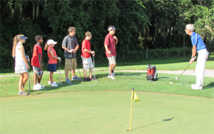 Image group of kids learning putting