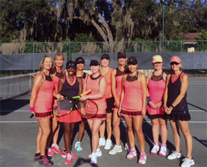 Photo - Group of Ladies posing on Tennis Court with Racquets