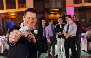Generic Photo of Groom getting ready to through a garter