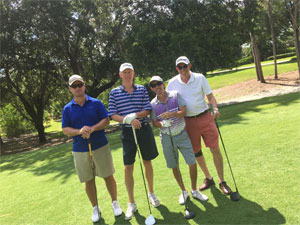 Photo foursome of Golfers posing with a Club