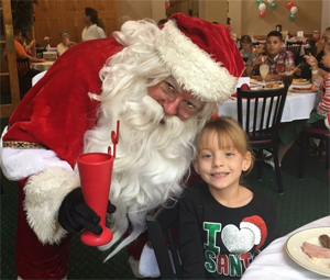 Photo of Girl and Santa Clause