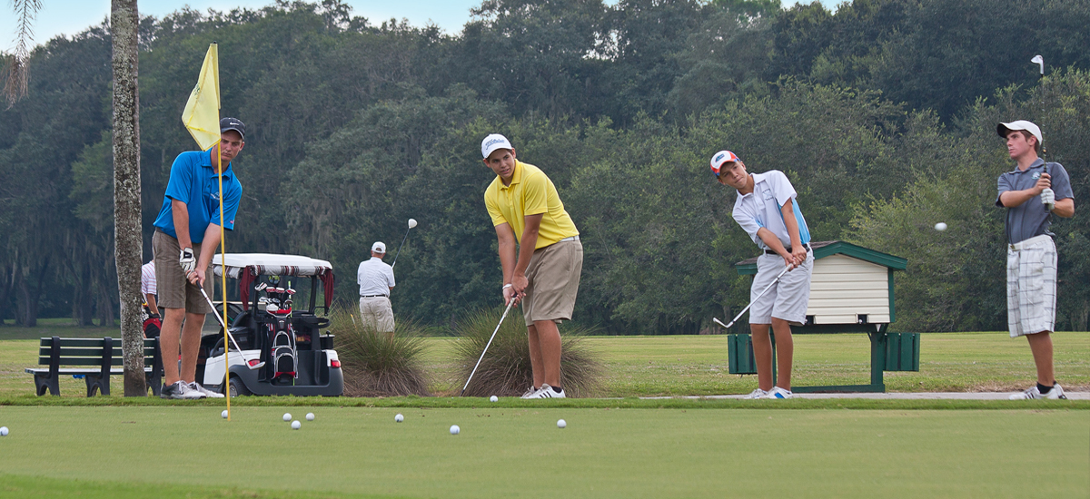 Photo Header River Hills Golfers Practicing Putting on Green