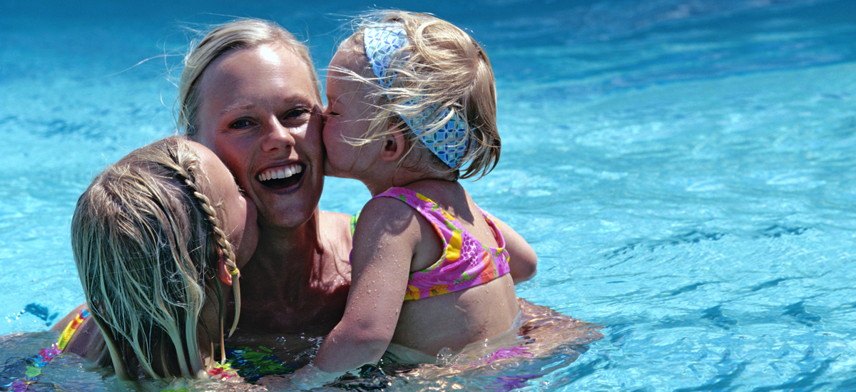 Photo Header River Hills Country Club Woman with 2 young girls in Swimming Pool