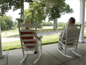 Photo - Couple sitting in rocking chairs on patio