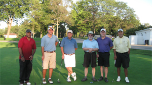 Group of 6 male golfers posing for a photo