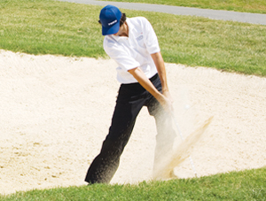 Photo - Golfer hitting ball out of sandtrap