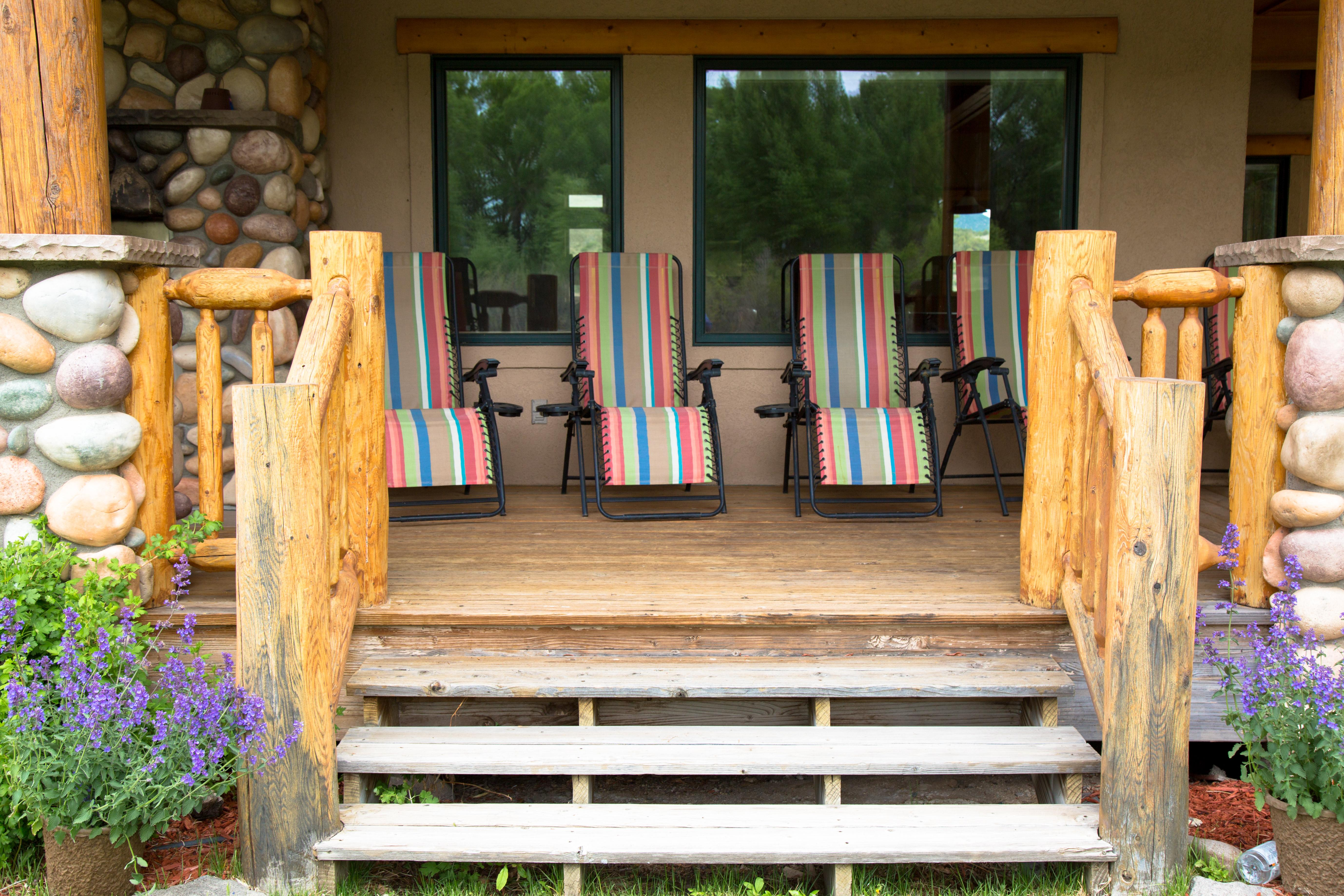 zero gravity chairs lined up on the porch of the fishing lodge