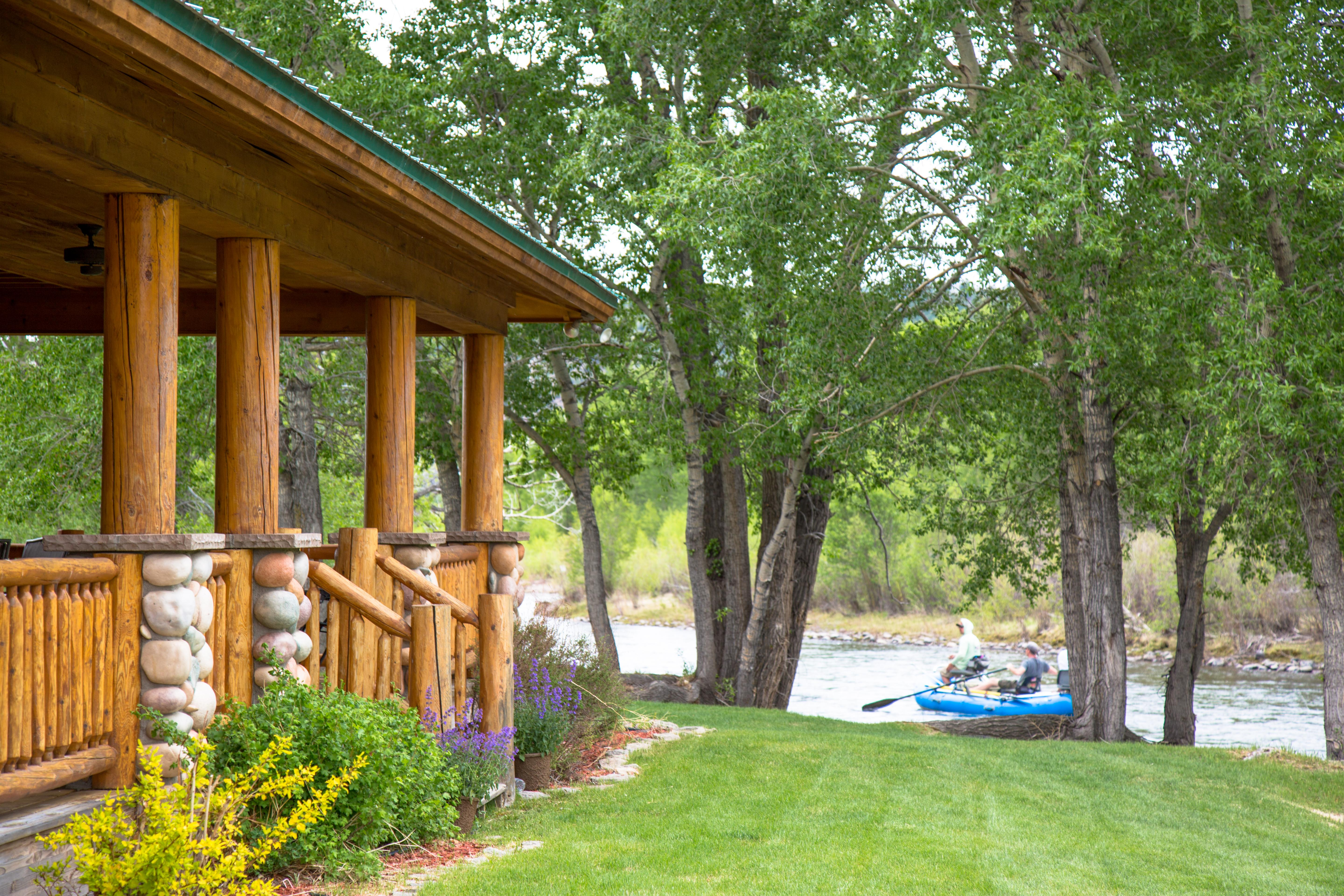 Fishing lodge exterior located right on the river next to hole #3 on the golf course